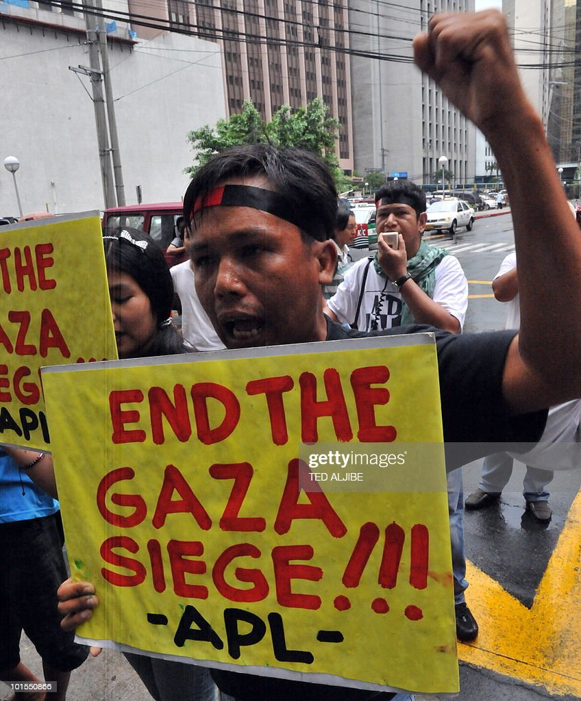 A Protester carries a placard and shouts anti-Israeli slogans during a pro-Palestinian protest condemning the Israeli military action against the aid flotilla outside the building housing Israeli embassy in the financial district of Manila on June 2, 2010. Activists in the Philippines on June 2, strongly condemned what they called a brutal attack by Israel on a Gaza-bound aid flotilla that left nine people dead.