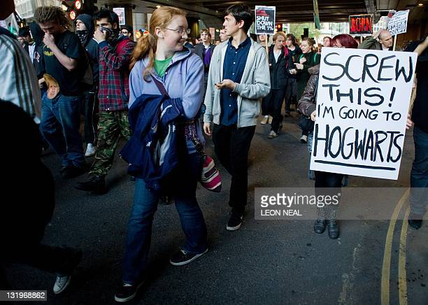 A protester carries a placard that reads 'Screw this I'm going to Hogwarts' in reference to the school of witchcraft and wizardry from the Harry...