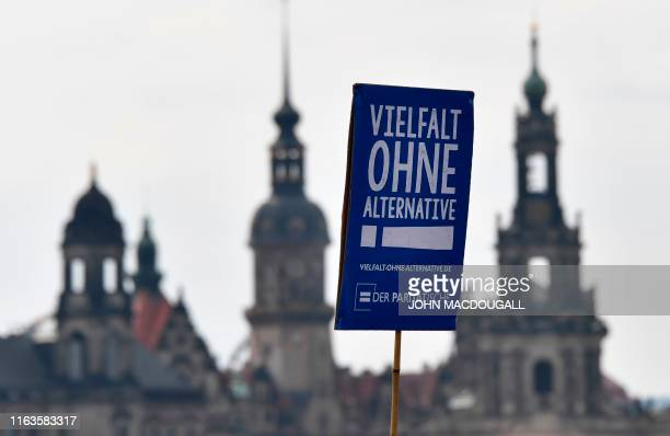A protester carries a poster reading Diversity without alternative during a demonstration titled Unteilbar against exclusion on August 24 2019 in...