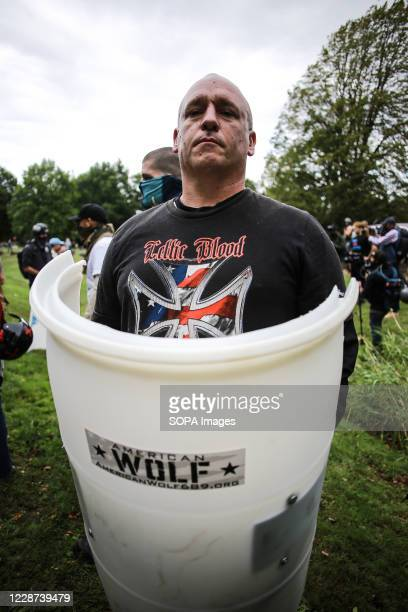 Protester carries a shield that was handed out during the Proud Boys rally. Hundreds of members of the far-right group Proud Boys arrived at Delta...