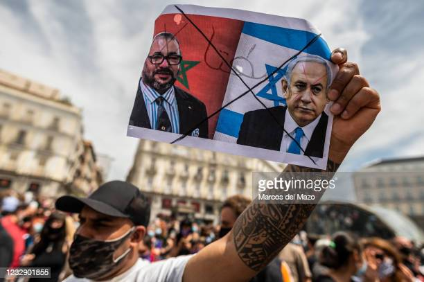 Protester carrying pictures of Moroccan and Israel Presidents during a demonstration against the last attacks by Israel to Palestinian people and...