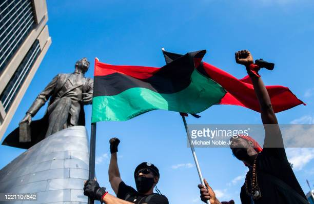 Protester chant near the Adam Clayton Powell Jr statue during a Juneteenth celebration on June 19 2020 in New York City Juneteenth commemorates June...
