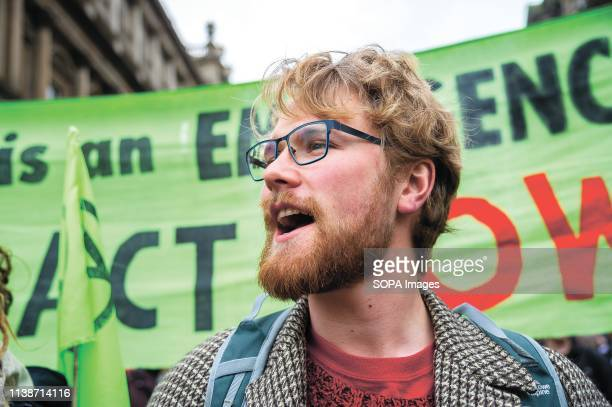 A protester chanting slogans during the demonstration Extinction Rebellion held a lockdown of Edinburgh's North Bridge as part of an international...