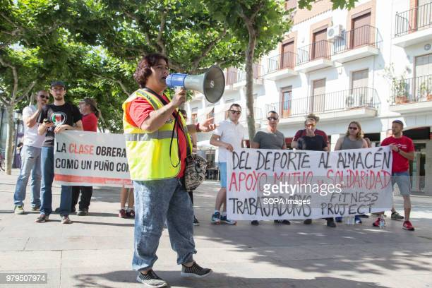 Protester chanting slogans with a loudspeaker during the demonstration Workers of the HM logistic center in Madrid has gone on strike and took to the...