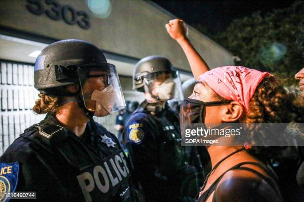 Protester chants directly in front of a police officer during the demonstration. A peaceful protest, spurred by the death of George Floyd, turned...