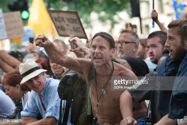Protester chants slogan while making gestures outside Downing street during the demonstration. Demonstrators protest in Trafalgar Square, London as...