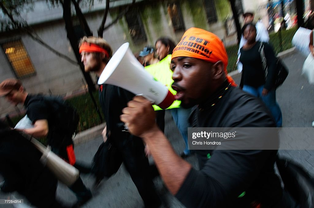A protester chants slogan with a megaphone while marching on Columbia University's main campus October 10, 2007 in New York. The rally was held to protest the discovery of a noose on the office door of an African-American professor.