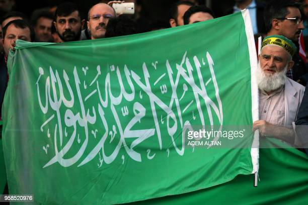 A protester chants slogans as he holds a Hamas flag outside the residence of the Israeli Ambassador in Ankara on May 14 2018 during a demonstration...