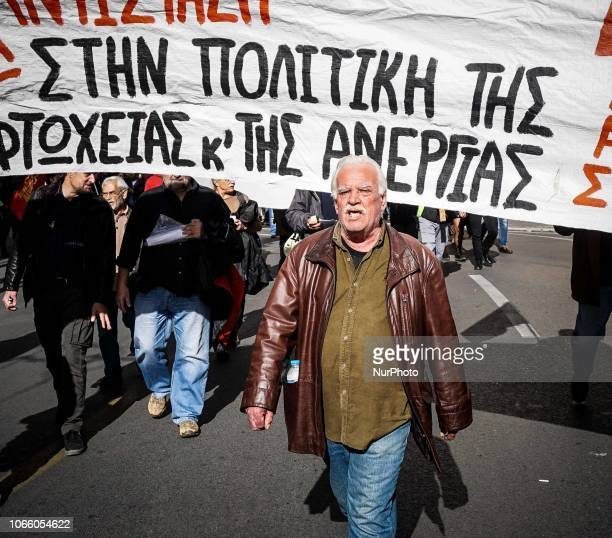 A protester chants slogans as he takes part during a 24 hour strike in front of the Hellenic Parliament building in Athens Greece 28 November...