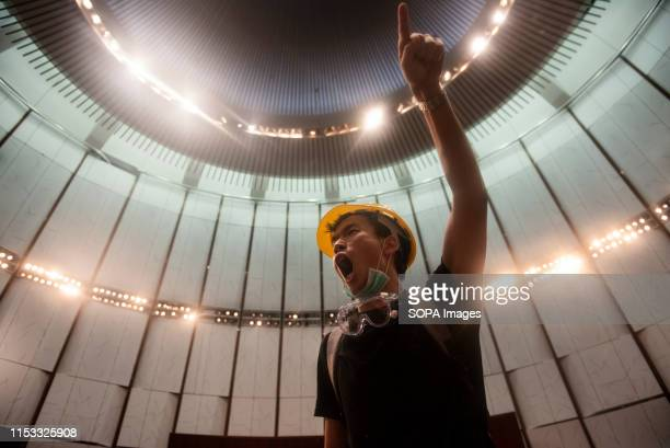 A protester chants slogans during the demonstration Hundreds of antigovernment protesters stormed into the legislative council building as the Hong...