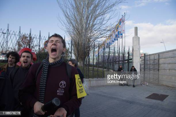Protester chants slogans during the demonstration. There was a spontaneous saucepan protest at the entrance of COP25 where climate change activists...