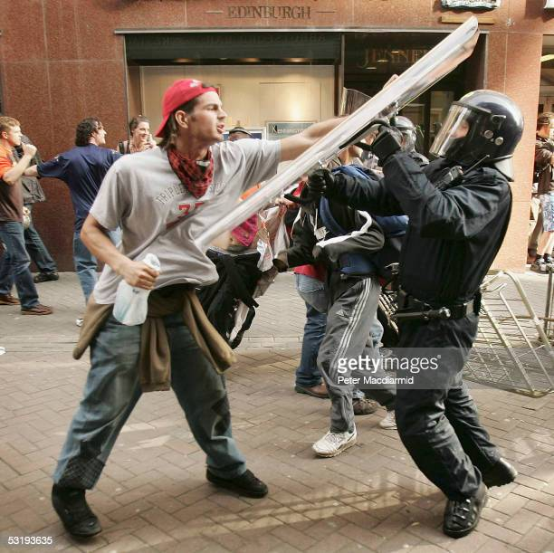 A protester clashes with a riot policeman on July 4 2005 in Edinburgh Scotland The protest is one of several organised protests that lead up to the...