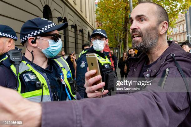 A protester clashes with police during the Coronavirus AntiLockdown Protest at Parliament House on 10 May 2020 in Melbourne Australia