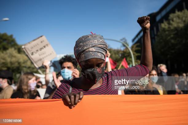 Protester clenches her fist during a demonstration for the evacuation of all migrant camps in Greece after the fire at the Moria refugee camp on...