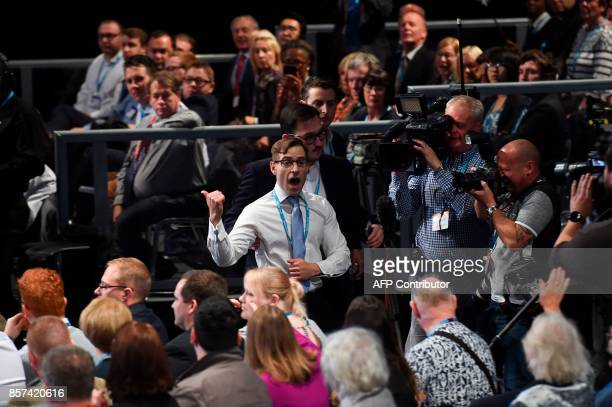 Protester comedian Simon Brodkin leaves the auditioum after delivering a piece of paper written as a mock P45 to Britain's Prime Minister Theresa May...