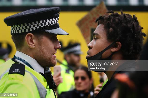 A protester confronts a Police Officer during a Black Lives Matter protest on June 06 2020 in London United Kingdom The death of an AfricanAmerican...