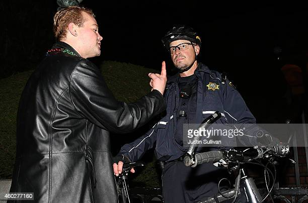 A protester confronts a UC Berkeley police officer during a demonstration over recent grand jury decisions in policeinvolved deaths on December 10...
