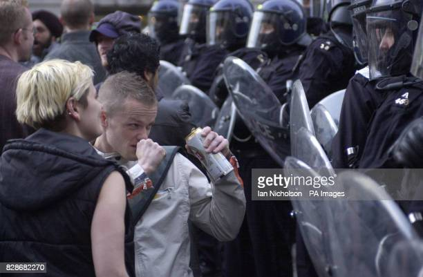 A protester confronts police during a May Day demonstration in London's Trafalgar Square