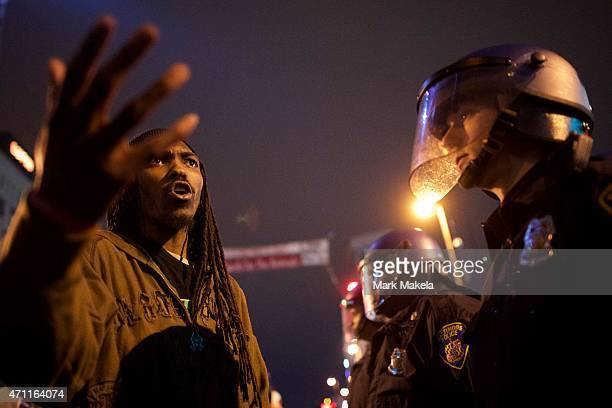 A protester confronts police in riot gear following a gathering in honor of Freddie Gray April 25 2015 in Baltimore Maryland Freddie Gray was...