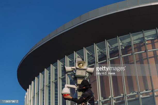 A protester covers surveillance cameras during antiextradition bill march in Hong Kong on July 21 2019 in Hong Kong Hong Kong Prodemocracy protesters...