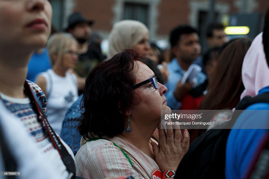 A protester cries and gestures as she listens a speech at the end of a demonstration to show solidarity and support for refugees on September 12, 2015 in Madrid, Spain. Several cities across Spain have called for demonstrations under the slogan 'Welcome refugees. For a more responsible European policy'. Europe is facing the region's largest crisis of migrants and refugees since World War II. Spain would have to take nearly 15,000 refugees under a new European Union plan to relocate 120,000 refugees. Many Spanish cities and citizens took the lead on offering their support to refugees.