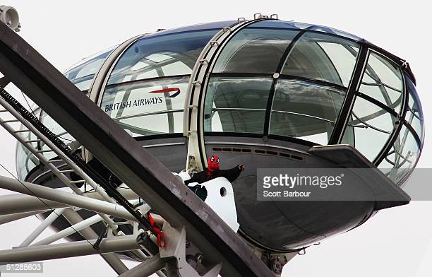 Protester David Chick sits atop the London Eye dressed in a Spiderman suit on September 11, 2004 in London, England. The civl rights group campaigner...