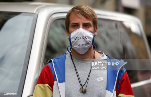 Protester demonstrates against restrictions on public life designed to stem the spread of the coronavirus, or COVID-19, on April 25, 2020 on Rosa...