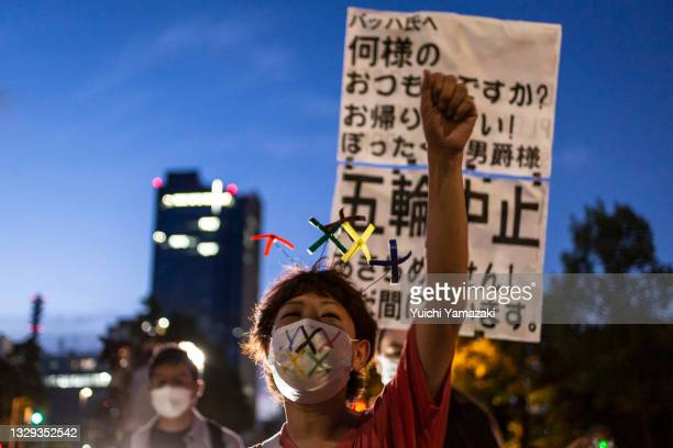 Protester demonstrates against the forthcoming Tokyo Olympic Games on July 18, 2021 in Tokyo, Japan. Protesters gathered near the Akasaka State Guest...