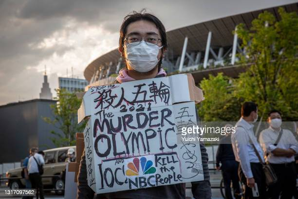Protester demonstrates against the Tokyo Olympics on May 09, 2021 in Tokyo, Japan. With less than 3 months remaining until the Tokyo 2020 Olympics...