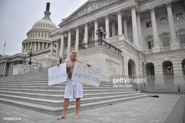 A protester demonstrates for Republicans and against legalized abortion outside the US Capitol in Washington DC on October 5 2018 The US Senate...