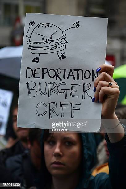 A protester demonstrates outside a Byron burger restaurant on August 1 2016 in London England Protesters are opposing an alleged training exercise...