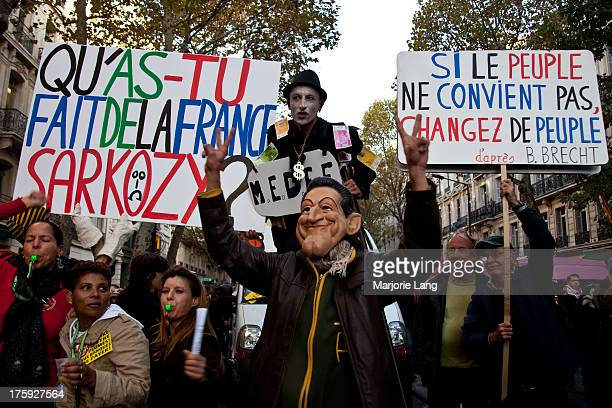 Protester disguised as Nicolas Sarkozy is posing during a big demonstration in the streets of Paris against the Sarkozy pension reform on 28th...