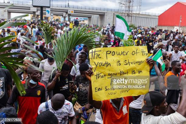 Protester displays a placard at the entrance of the Murtala Muhammed Airport during ongoing protest against the unjust brutality of The Nigerian...