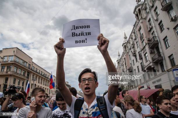 A protester displays a placard during the demonstration Anticorruption protest organised by opposition leader Alexei Navalny at Tverskaya Street