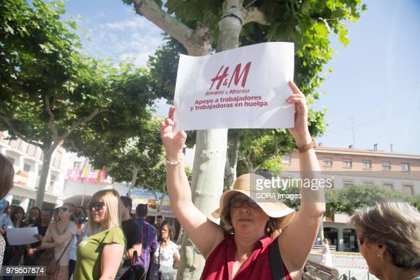 Protester displays a placard in support of the HM workers Workers of the HM logistic center in Madrid has gone on strike and took to the street of...