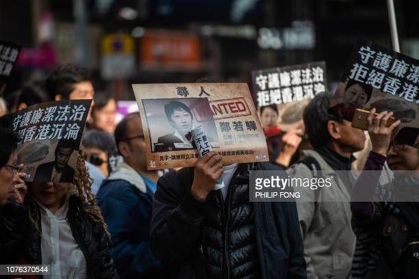 A protester displays a placard of Hong Kong's Secretary for Justice Teresa Cheng during the annual New Year's Day prodemocracy rally in Hong Kong on...