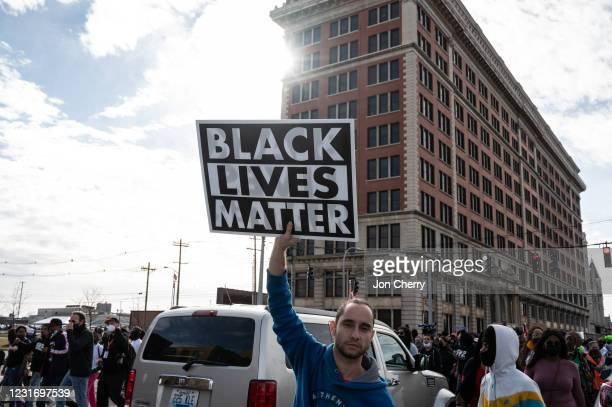 Protester displays his Black Lives Matter sign during a Breonna Taylor memorial march near Jefferson Square Park on March 13, 2021 in Louisville,...