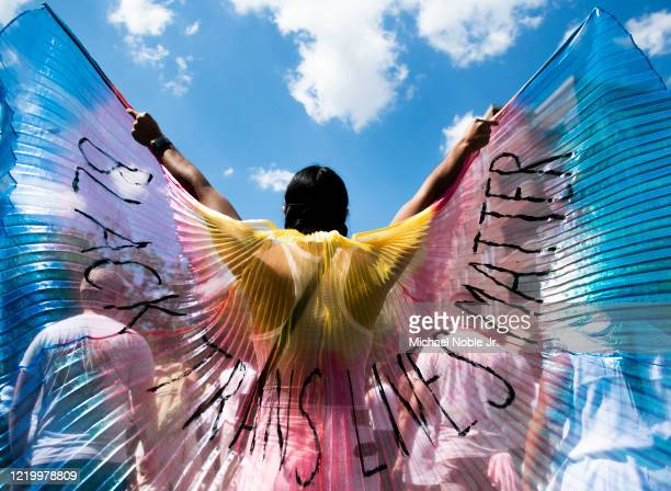 A protester displays wings while marching on on June 14 2020 in the Brooklyn borough of New York City Protests continue in locations all around the...