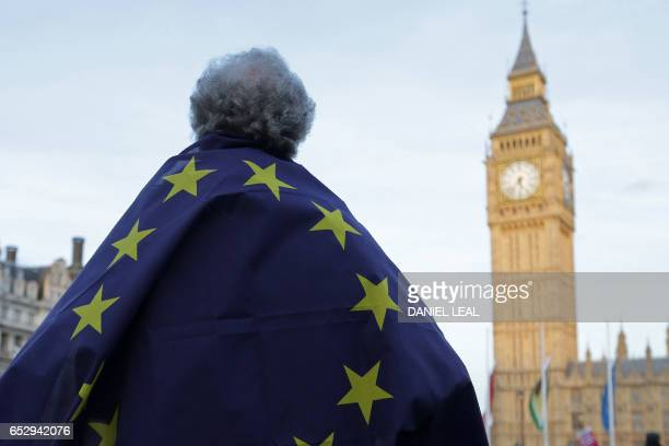 A protester draped in a European Union flag takes part in a protest in support of an amendment to guarantee legal status of EU citizens outside the...