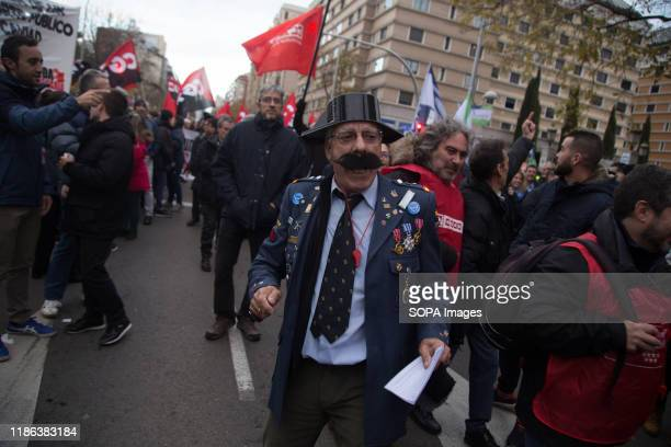 Protester dressed as a Civil Guard takes part during the demonstration. EMT workers protest supported by Metro and taxi workers. The bus drivers of...