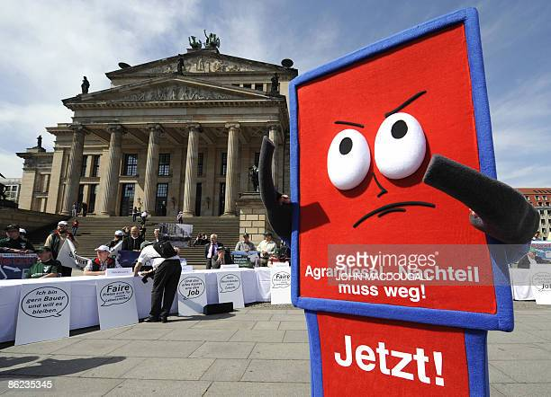A protester dressed as a petrol pump takes part in a demonstration by the German Farmers' Association during a protest at Berlin's Gendarmenmarkt...