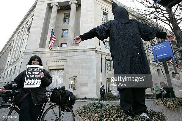 A protester dressed as an abused prisoner at Abu Ghraib prison in Iraq is seen during a demonstration February 22 2005 outside the Justice Department...