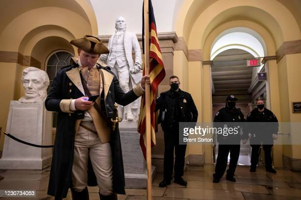Protester dressed as George Washington debates with a Capitol Police before being pushed out. Supporters of US President Donald Trump protested...