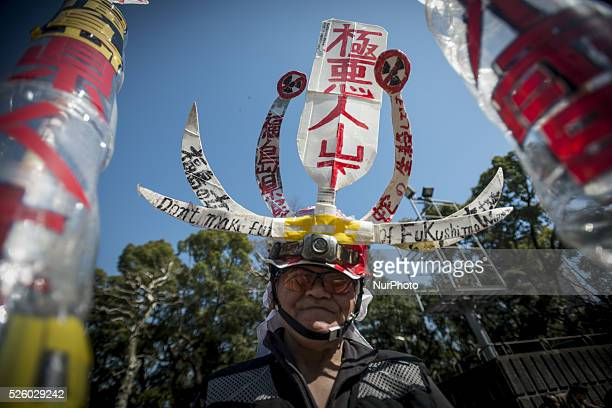 A protester dressed as manga takes part in the demo to not forget the victims of Fukushima March 2 2016 in Tokyo organized by quotHidanrenquot the...