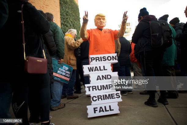 A protester dressed as President Donald Trump holds a placard while demonstrating with Philadelphia Airport TSA and airport workers outside the...