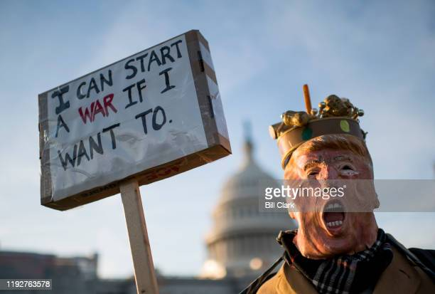 Protester dressed as President Donald Trump holds a sign which read I can start a war if I want to participates in the No War With Iran rally outside...