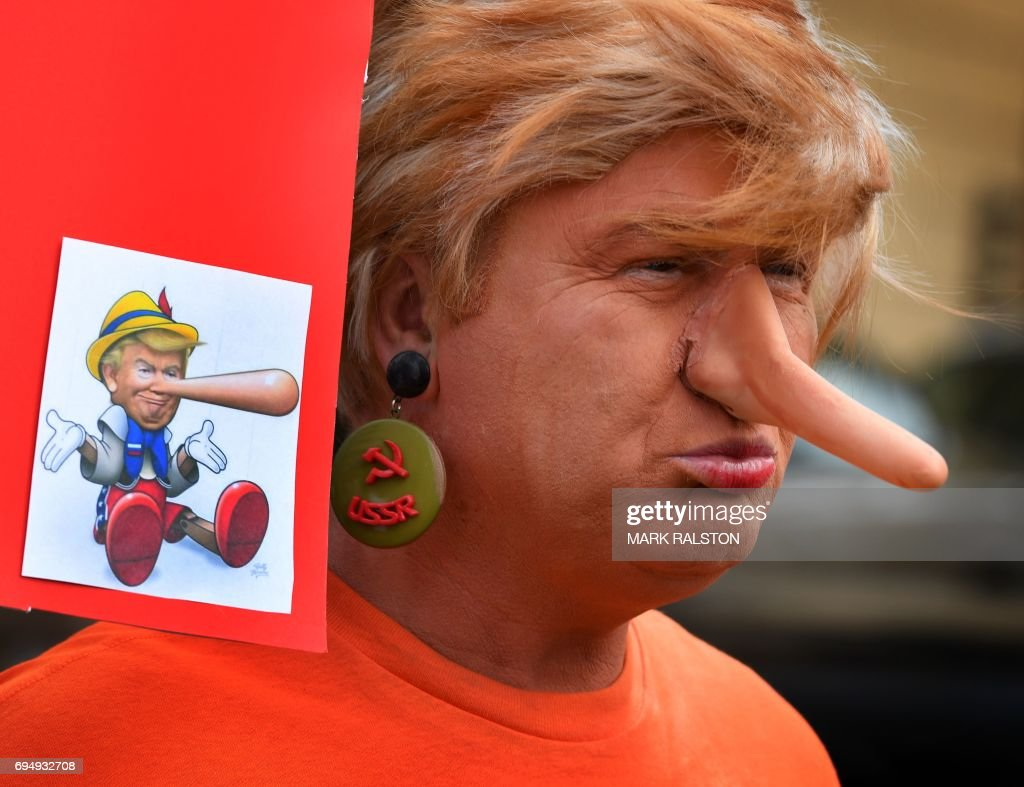 A protester dressed as the President Donald Trump waits for the start of the #ResistMarch during the 47th annual LA Pride Festival in Hollywood, California on June 11, 2017. Inspired by the huge women's marches that took place around the world following the inauguration of President Trump, LA Pride has replaced its decades-old parade with a protest march. / AFP PHOTO / Mark RALSTON