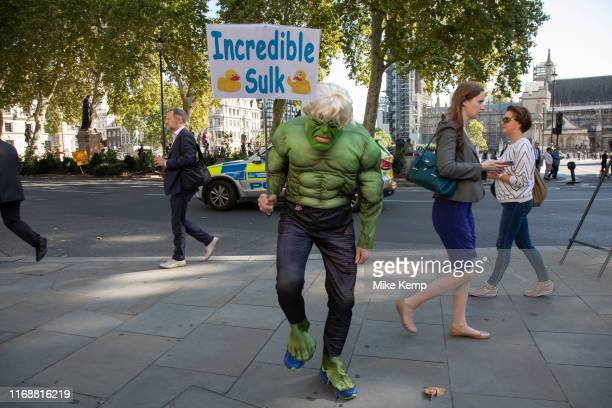 Protester dressed up as the Incredible Hulk with his 'Incredible Sulk' placard in reference to Boris Johnson's recent comment 'The madder Hulk gets...