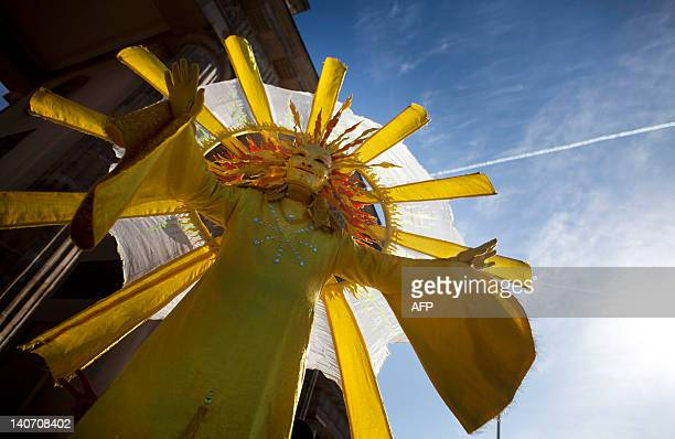 Protester dressed up as the sun takes part in a rally against government's plans to cut subsidies for the solar power sector the German government's...