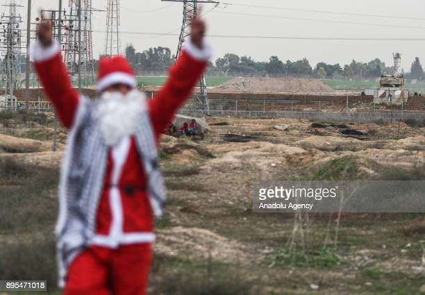 A protester dressing up as Santa Clause gestures during a protest against US President Donald Trump's announcement to recognize Jerusalem as the...